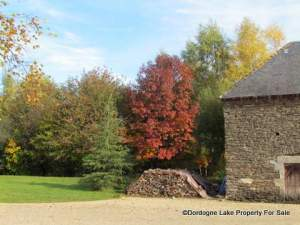 Log store Front drive autumn #dordognelakeproperty