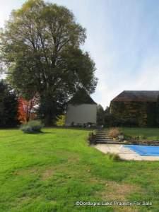 side of house and barn hanger #dordognelakeproperty
